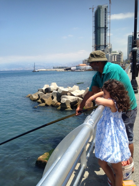 Salma helping a fisherman along the corniche
